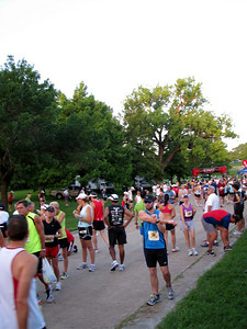 The runners start lining up for the race.