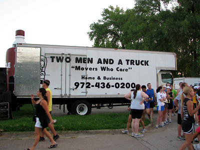 Runners infront of the truck.