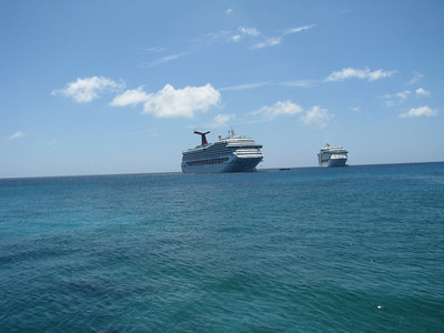 The Conquest and a Royal Caribbean ship.