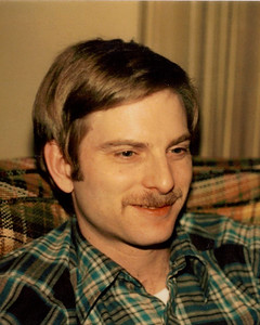 This is one of my favorite pictures of him. Taken around 1991 or so at his folks' house. He almost always had that mustash. He did shave it off once at my request, but then got carded when he went to buy some beer. The mustash was quickly grown back and stayed back.