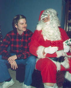 Have you been a good boy this year?  Larry with Santa Bob