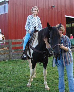 """Take my picture! I want proof for my family that I was on a horse!""  Freida was amazed that she could see these pictures on the camera display that night. For 82, she was pretty spry!"