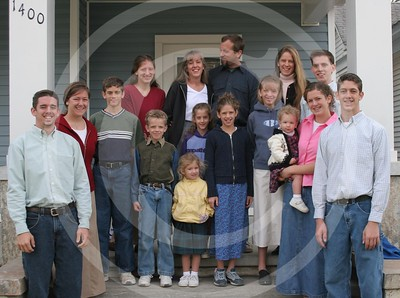 Our Family photo. L to R Back row: Justin, Mandy, Jack, Annie, Mom, Dad, Tiffany, Chris. Front row: Trevor, Kaylee, Charity, Alyssa, Joanna, Heidi, Merrie, Will.