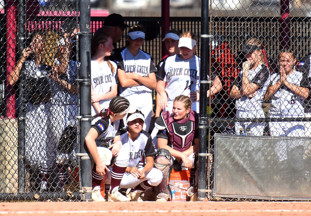 . The Silver Creek softball team watches from the dugout during the softball state championships on Friday at Aurora Sports Park. (Photo by Brad Cochi/BoCoPreps.com)
