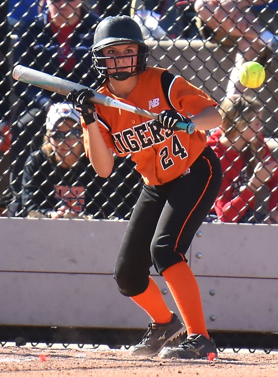 . Erie�s Morgan Weber squares around to bunt during the softball state championships on Friday at Aurora Sports Park. (Photo by Brad Cochi/BoCoPreps.com)