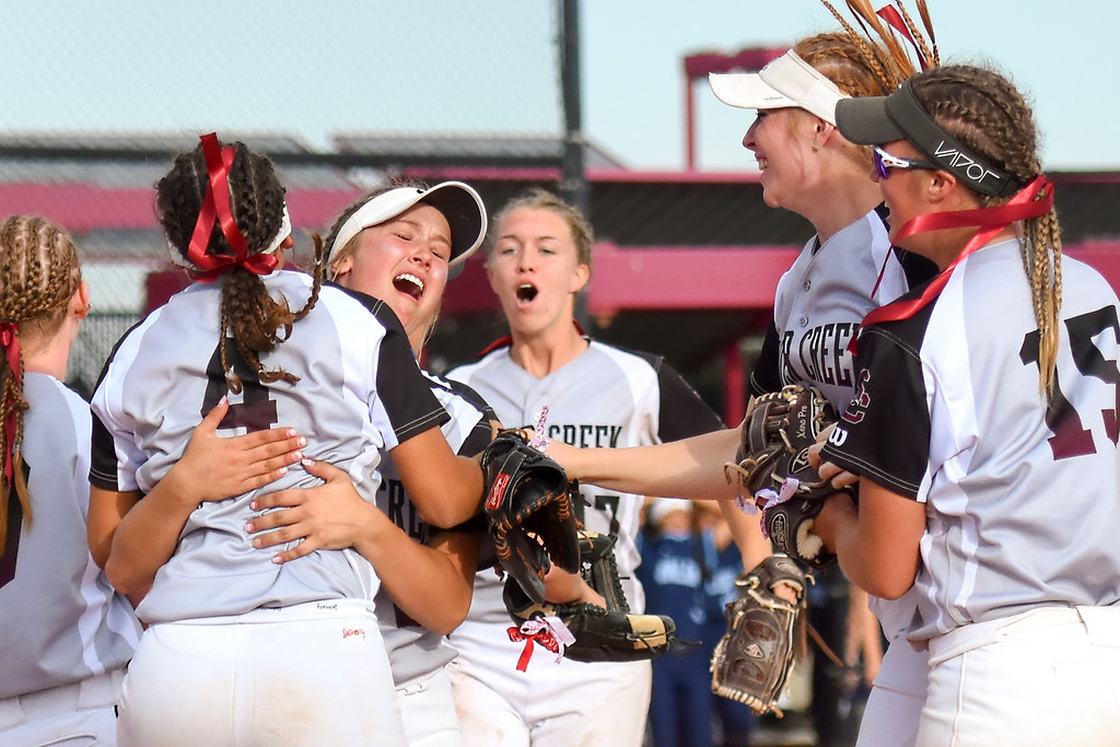 . Silver Creek�s Makayla Garcia jumps on Emma Flynn while the Raptors celebrate their victory over top-seeded Valor Christian in the quarterfinals for the Class 4A softball state championships on Friday at Aurora Sports Park. (Photo by Brad Cochi/BoCoPreps.com)