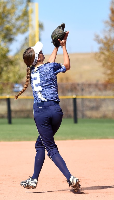 . Frederick�s Brittlyn Massey makes a running catch during the softball state championships on Friday at Aurora Sports Park. (Photo by Brad Cochi/BoCoPreps.com)
