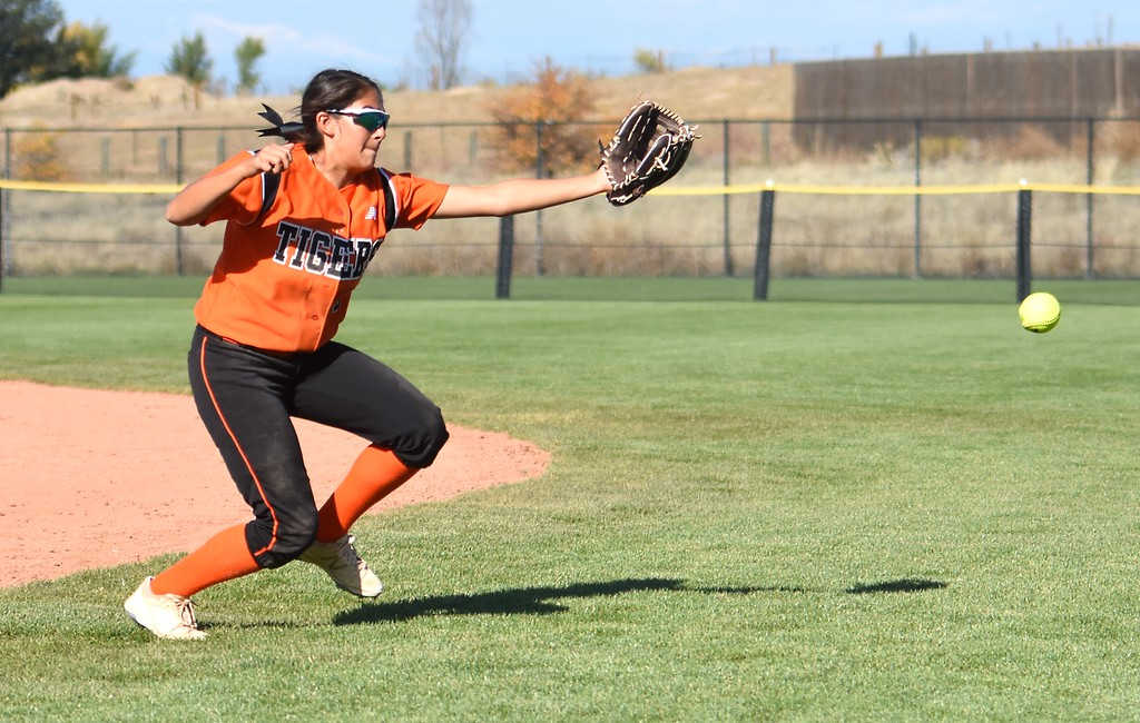 . Erie�s Sloane Quijas nearly makes an over-the-shoulder catch during the softball state championships on Friday at Aurora Sports Park. (Photo by Brad Cochi/BoCoPreps.com)
