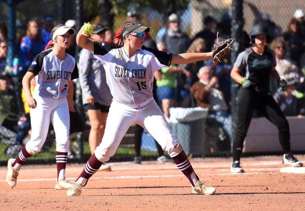 . Silver Creek first baseman throws across the diamond during the softball state championships on Friday at Aurora Sports Park. (Photo by Brad Cochi/BoCoPreps.com)