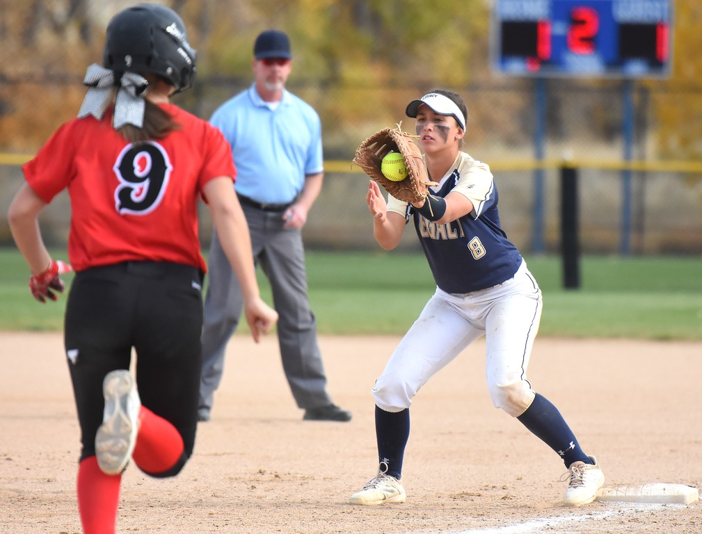 . Legacy�s Trisha Cook makes an out at first base during the softball state championships on Friday at Aurora Sports Park. (Photo by Brad Cochi/BoCoPreps.com)
