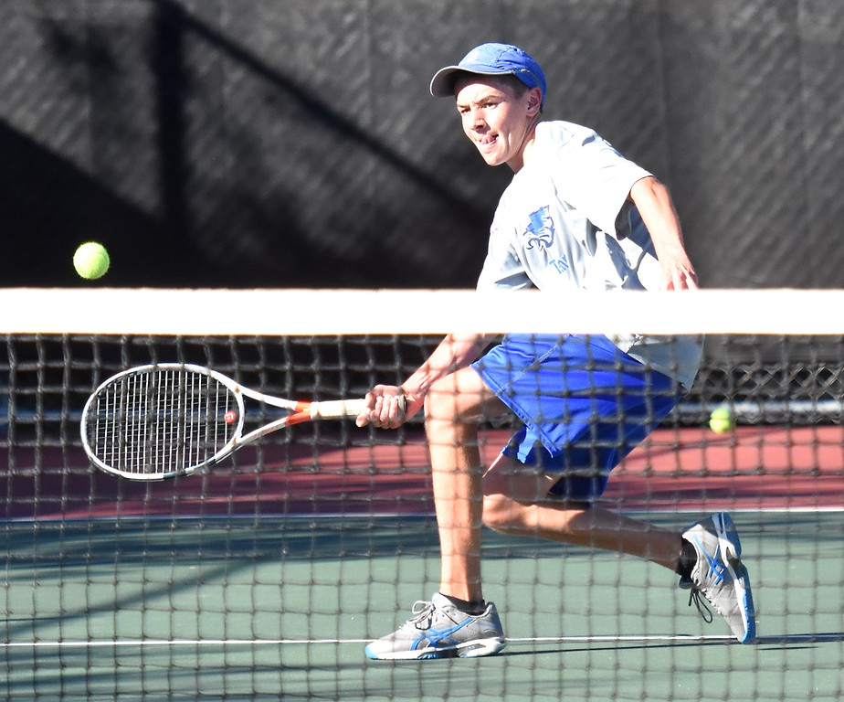. Broomfield No. 3 singles player Mason Lewis reaches a drop shot at the net during Day 1 of the Class 5A boys tennis state championships on Thursday at Gates Tennis Center in Denver. (Photo by Brad Cochi/BoCoPreps.com)