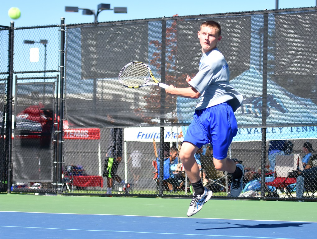 . Broomfield No. 2 doubles player Cameron Lupo blasts a forehand during Day 1 of the Class 5A boys tennis state championships on Thursday at Gates Tennis Center in Denver. (Photo by Brad Cochi/BoCoPreps.com)