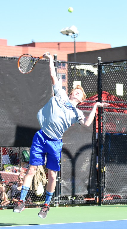 . Broomfield�s Mitchell Manwaring fires a leaping serve during Day 1 of the Class 5A boys tennis state championships on Thursday at Gates Tennis Center in Denver. (Photo by Brad Cochi/BoCoPreps.com)