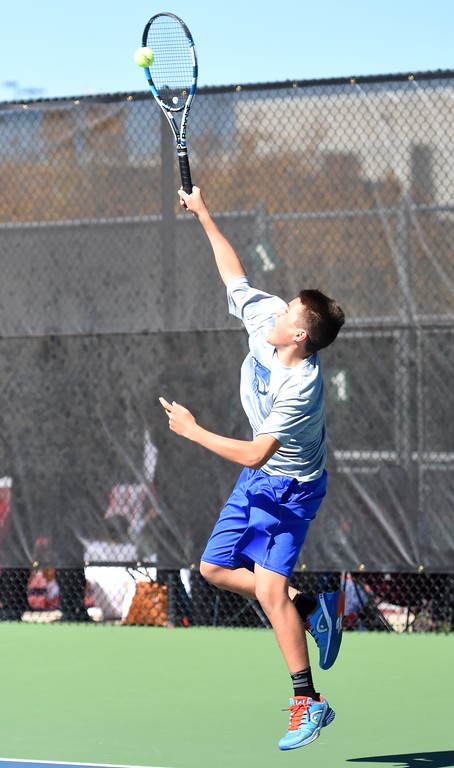 . Broomfield�s Henry Kuhna fires a serve during Day 1 of the Class 5A boys tennis state championships on Thursday at Gates Tennis Center in Denver. (Photo by Brad Cochi/BoCoPreps.com)