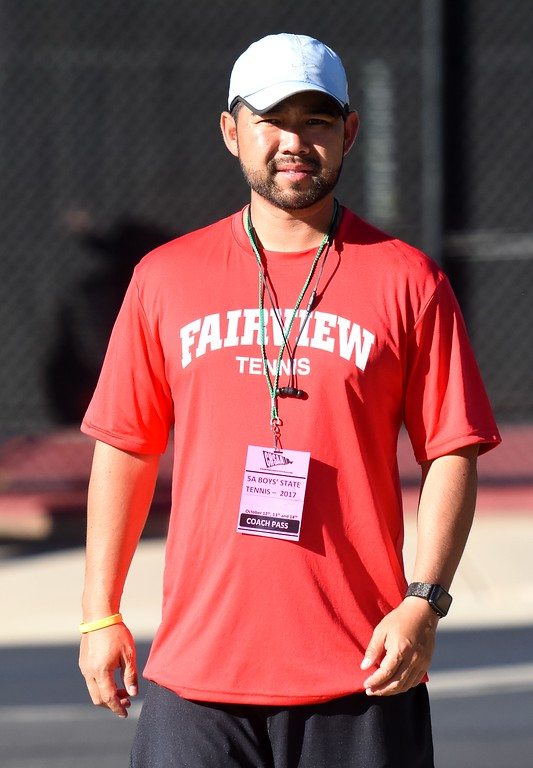 . Fairview head coach Chad Tsuda looks from one court to another while his team plays during Day 1 of the Class 5A boys tennis state championships on Thursday at Gates Tennis Center in Denver. (Photo by Brad Cochi/BoCoPreps.com)