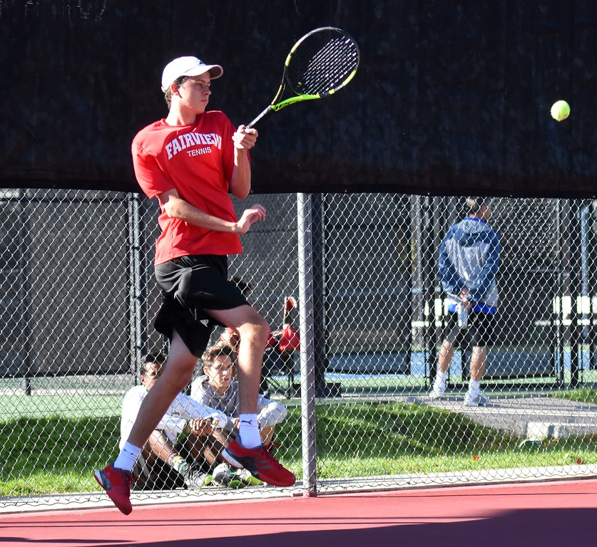 . Fairview No. 2 singles player Ethan Schacht returns a serve during Day 1 of the Class 5A boys tennis state championships on Thursday at Gates Tennis Center in Denver. (Photo by Brad Cochi/BoCoPreps.com)