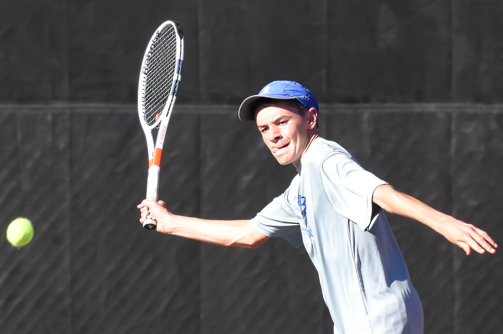 . Broomfield�s Mason Lewis hits a forehand during Day 1 of the Class 5A boys tennis state championships on Thursday at Gates Tennis Center in Denver. (Photo by Brad Cochi/BoCoPreps.com)