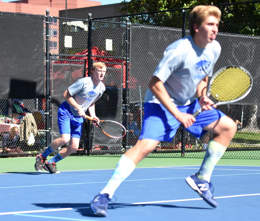 . Broomfield�s Mitchell Manwaring (back) follows his serve while No. 1 doubles teammate Jack Vanderberg moves to the net during Day 1 of the Class 5A boys tennis state championships on Thursday at Gates Tennis Center in Denver. (Photo by Brad Cochi/BoCoPreps.com)