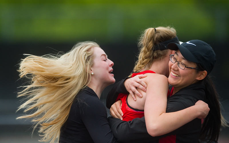 "Fairview High School's Natalie Munson (left) and Angela Cai (right) hug Sophie Pearson after Pearson defeated Cherry Creek's  Sayuri Garud in a 6-3 victory, winning the state title for their team during the 5A State Tennis Championship Tournament at Gates Tennis Center in Denver on Saturday. <br /> More photos:  <a href=""http://www.BoCoPreps.com"">http://www.BoCoPreps.com</a><br /> Autumn Parry/Staff Photographer<br /> May 14, 2016"