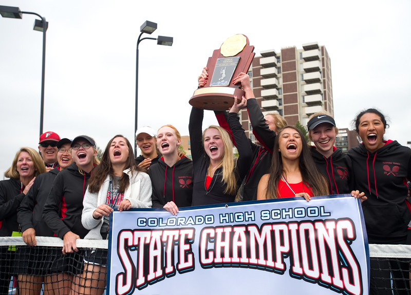 "Fairview High School's girls tennis team cheer in celebration after they received their trophy for winning the state title during the 5A State Tennis Championship Tournament at the Gates Tennis Center in Denver on Saturday.<br /> More photos:  <a href=""http://www.BoCoPreps.com"">http://www.BoCoPreps.com</a><br /> Autumn Parry/Staff Photographer<br /> May 14, 2016"
