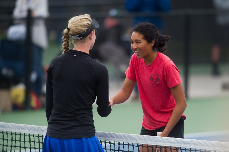 "Poudre High School's Ky Ecton (left) shakes hands with Fairview High School's Seraphin Castelino after Castelino defeated her in a #1 singles match during the 5A State Tennis Championship Tournament at the Gates Tennis Center in Denver on Saturday.<br /> More photos:  <a href=""http://www.BoCoPreps.com"">http://www.BoCoPreps.com</a><br /> Autumn Parry/Staff Photographer<br /> May 14, 2016"