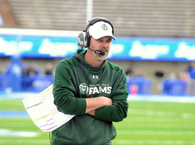 Colorado State coach Mike Bobo walks the sidelines during Thursday's game at Air Force. (Mike Brohard/Loveland Reporter-Herald).