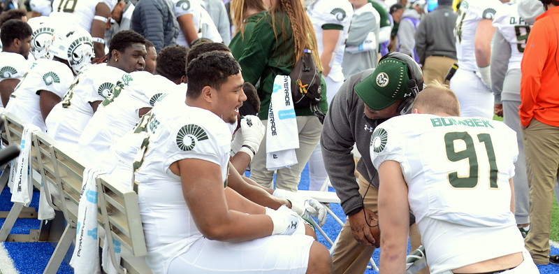Colorado State defensive line coach Keith Gilmore talks with Livingston Paogofie on the sidelines during Thursday's game at Air Force. (Mike Brohard/Loveland Reporter-Herald).