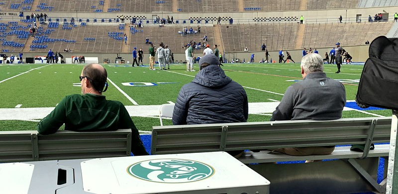 Colorado State head coach Mike Bobo, graduate assistant Fred Zerblis and offensive line coach Dave Johnson (left to right) sit on the team bench as they watch warmups prior to Thursday's game at Air Force. (Mike Brohard/Loveland Reporter-Herald)