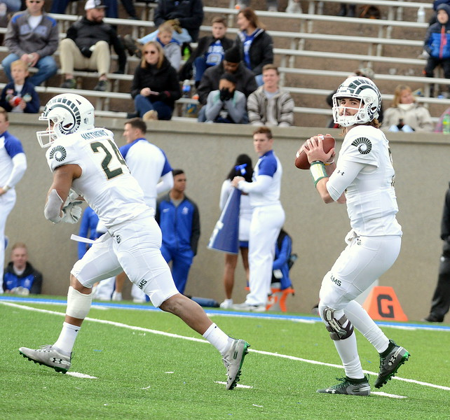 Colorado State quarterback Collin Hill looks for an open receiver during Thursday's game at Air Force. (Mike Brohard/Loveland Reporter-Herald).