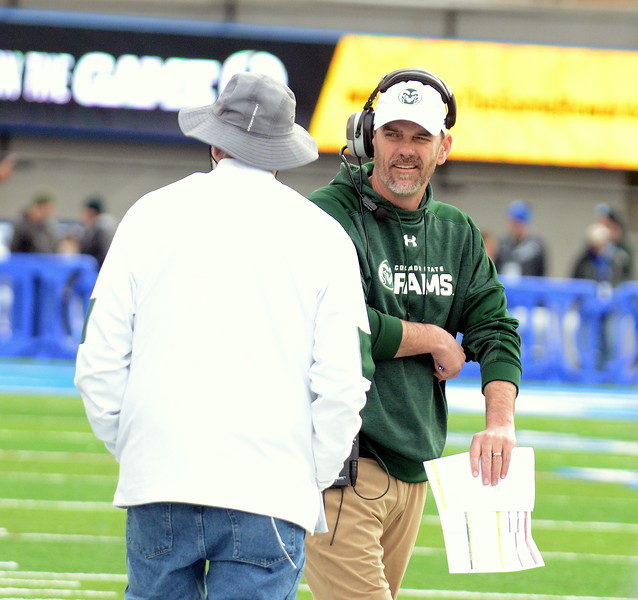 Colorado State head coach Mke Bobo talks with his father, George, on the sidelines during Thursday's game at Air Force. (Mike Brohard/Loveland Reporter-Herald).