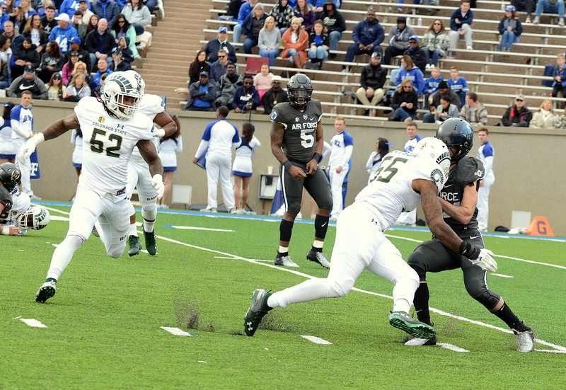 Colorado State linebacker Josh Watson makes a stop on Air Force back Kadin Remsberg during Thursday's game at Air Force. (Mike Brohard/Loveland Reporter-Herald).