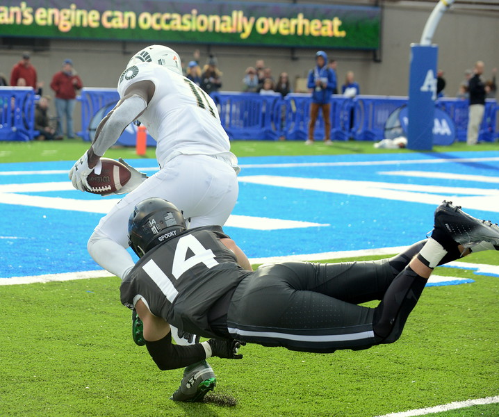 Colorado State's Preston Williams breaks through the tackle of Air Force's Grant Theil on his way to his first touchdown of the first half during Thursday's game at Air Force. (Mike Brohard/Loveland Reporter-Herald).