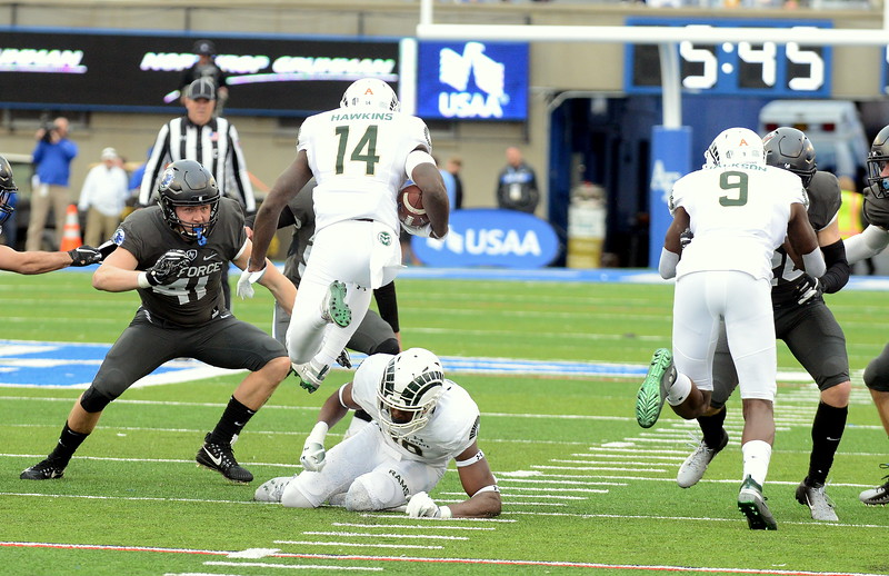 Colorado State kick returner Anthony Hawkins leaps over teammate Braylin Scott during the first quarter of Thursday's game at Air Force. (Mike Brohard/Loveland Reporter-Herald).