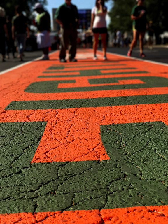 . Fans make their way down the painted section of campus designated for the Ram Walk portion of pregame where fans cheer the players to the new Colorado State Stadium on Saturday Aug. 26, 2017. (Cris Tiller / Loveland Reporter-Herald)