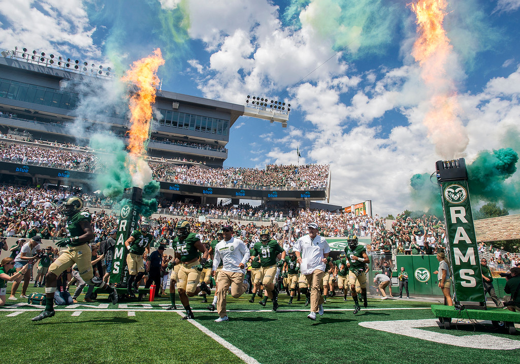 . Amid smoke and flame the Colorado State football team takes the field Saturday afternoon August 26, 2017 to face Oregon State in their inaugural football game at the new on-campus stadium in Fort Collins. (Michael Brian/For the Reporter-Herald)