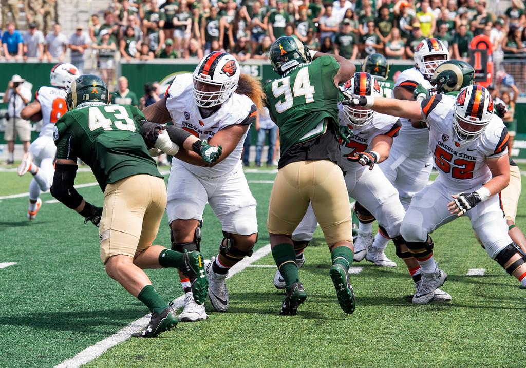 . Colorado State defenders Evan Colorito (43) and Darnell Thompson (94) work against the Oregon State offensive line Saturday afternoon August 26, 2017 at the new on-campus stadium in Fort Collins. The Rams beat the Beavers, 58-27. (Michael Brian/For the Reporter-Herald)