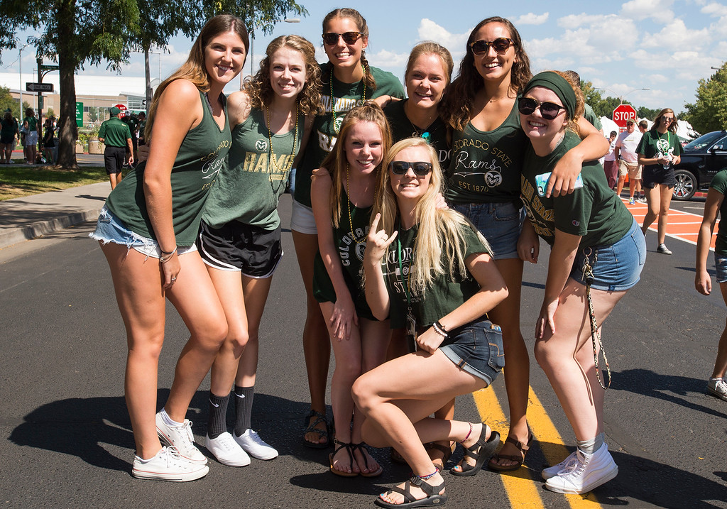 . A group of freshman students pose for a picture outside the CSU on-campus stadium Saturday morning August 26, 2017 prior to the Ram\'s inaugural football game at the new facility in Fort Collins. (Michael Brian/For the Reporter-Herald)