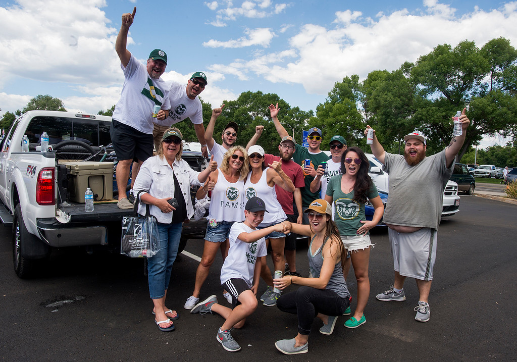 . A group of Ram fans tailgating in the Moby Arena lot pose for a photo Saturday morning August 26, 2017 prior to the Ram\'s inaugural football game at the new on-campus stadium in Fort Collins. (Michael Brian/For the Reporter-Herald)