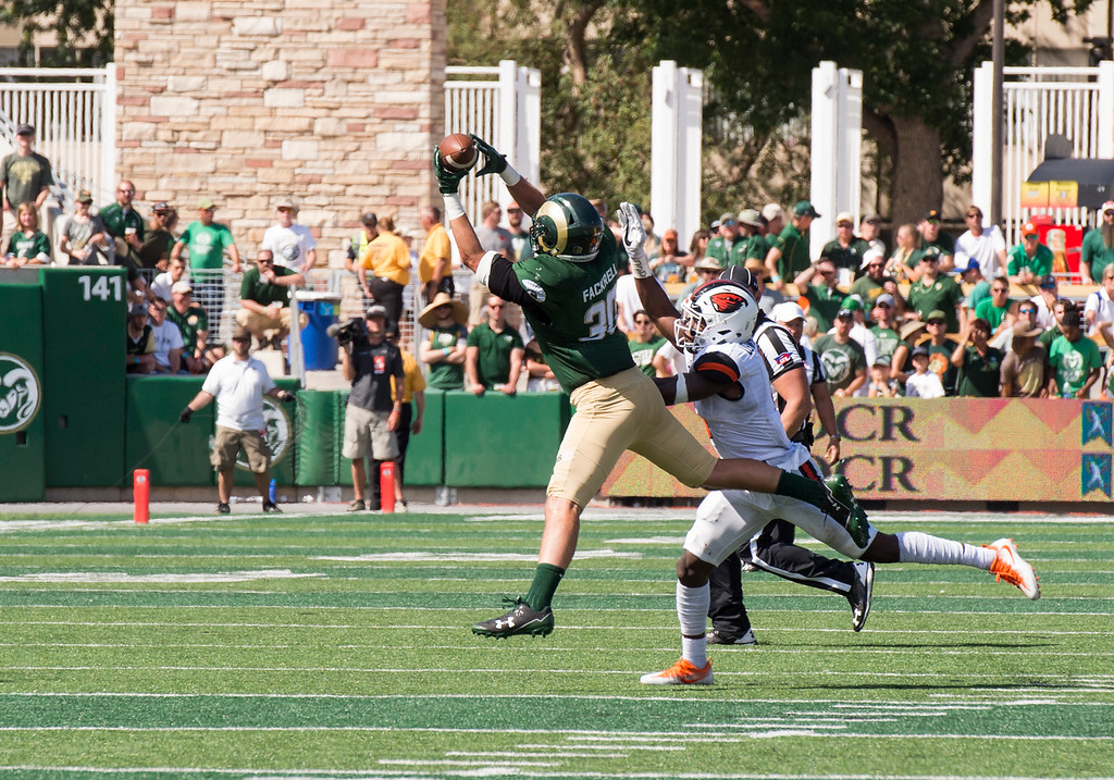 . Colorado State tight end Dalton Fackrell (30) catches a pass over the outreached hands of Oregon State outside linebacker Bright Ugwoegbu (1) Saturday afternoon August 26, 2017 at the new on-campus stadium in Fort Collins. The Rams won the game, 58-27. (Michael Brian/For the Reporter-Herald)