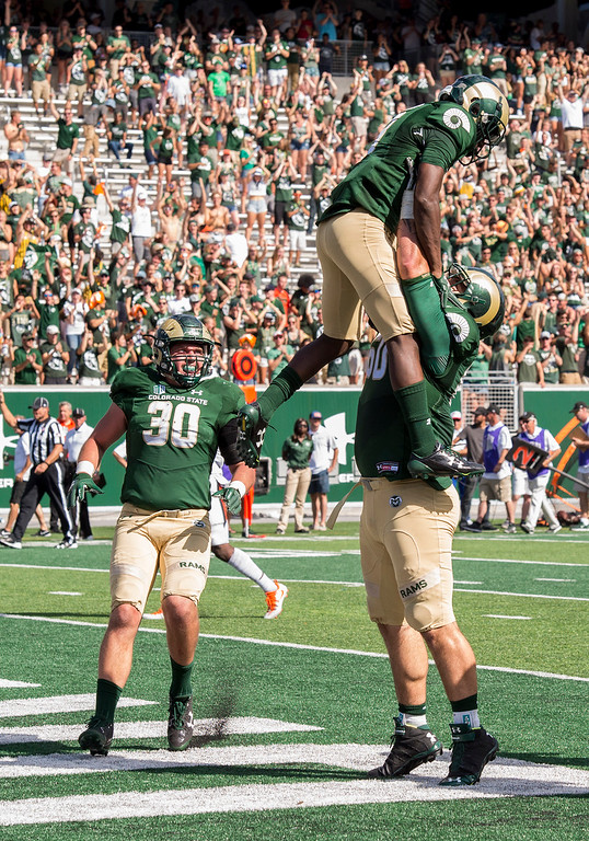 . Colorado State offensive lineman Trae Moxley (60) lifts wide receiver Detrich Clark (8) high in the air after Clark scored a touchdown against Oregon State Saturday afternoon August 26, 2017 at the new on-campus stadium in Fort Collins. The Rams beat the Beavers, 58-27. (Michael Brian/For the Reporter-Herald)