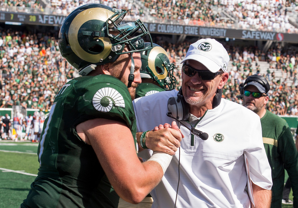. Colorado State\'s head coach Mike Bobo, right, celebrates a Rams touchdown with offensive lineman Jake Bennett (77) against Oregon State Saturday afternoon August 26, 2017 during the Ram\'s inaugural football game at the new on-campus stadium in Fort Collins. The Rams handled the Beavers easily, winning 58-27. (Michael Brian/For the Reporter-Herald)