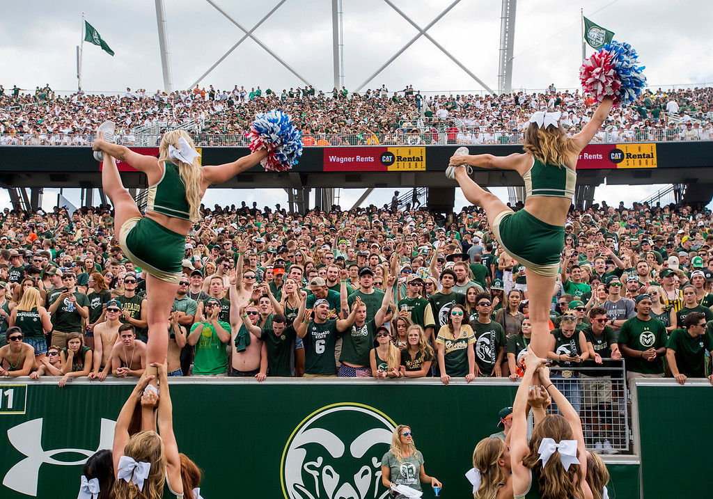 . A loud and boisterous crowd cheers along with the Rams Cheerleaders Saturday afternoon August 26, 2017 during the Ram\'s inaugural football game against Oregon State at the new on-campus stadium in Fort Collins. (Michael Brian/For the Reporter-Herald)