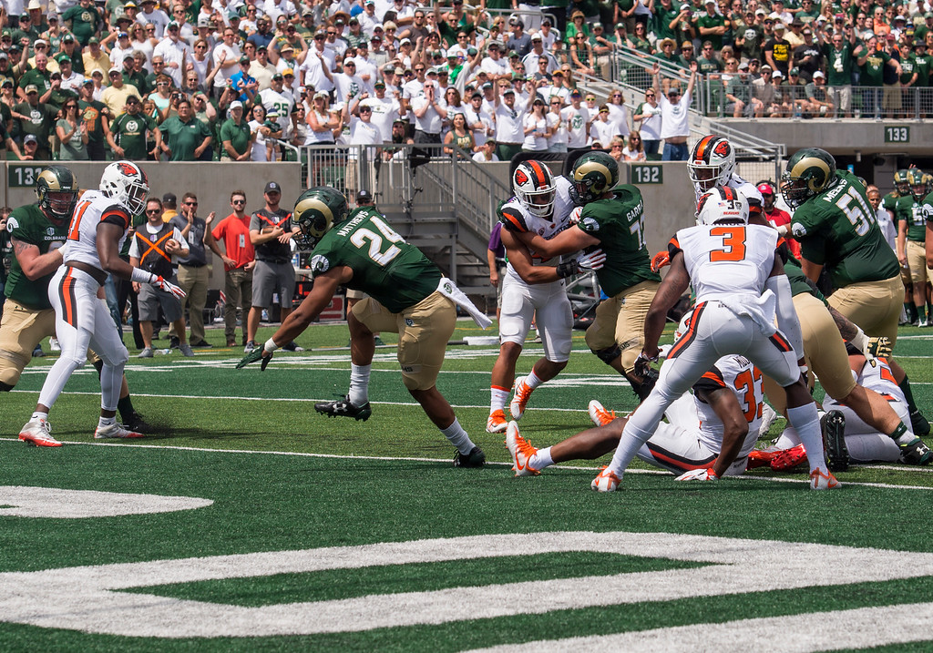 . Colorado State running back Izzy Matthews (24) spins into the end zone for the first Ram\'s touchdown against Oregon State Saturday afternoon August 26, 2017 in Fort Collins. (Michael Brian/For the Reporter-Herald)