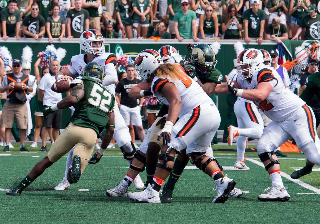 . Colorado State linebacker Tre Thomas (52) gets around the offensive line and closes in on Oregon State quarterback Jake Luton (6) Saturday afternoon August 26, 2017 at the new on-campus stadium in Fort Collins. The Rams beat the Beavers, 58-27. (Michael Brian/For the Reporter-Herald)