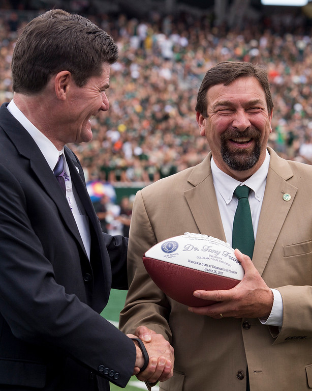 . Colorado State President Tony Frank receives a commemorative game ball as the football team opened the new on-campus stadium against Oregon State Saturday afternoon August 26, 2017 in Fort Collins. The Rams won their first game in the new facility, 58-27. (Michael Brian/For the Reporter-Herald)