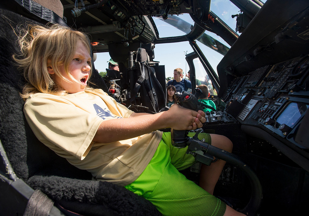 . Harrison Shields, 8, from Fort Collins, pretends to fly a UH-60 Blackhawk helicopter during pre-game festivites Saturday morning August 26, 2017 prior to the Ram\'s inaugural football game at the new CSU on-campus stadium in Fort Collins. (Michael Brian/For the Reporter-Herald)