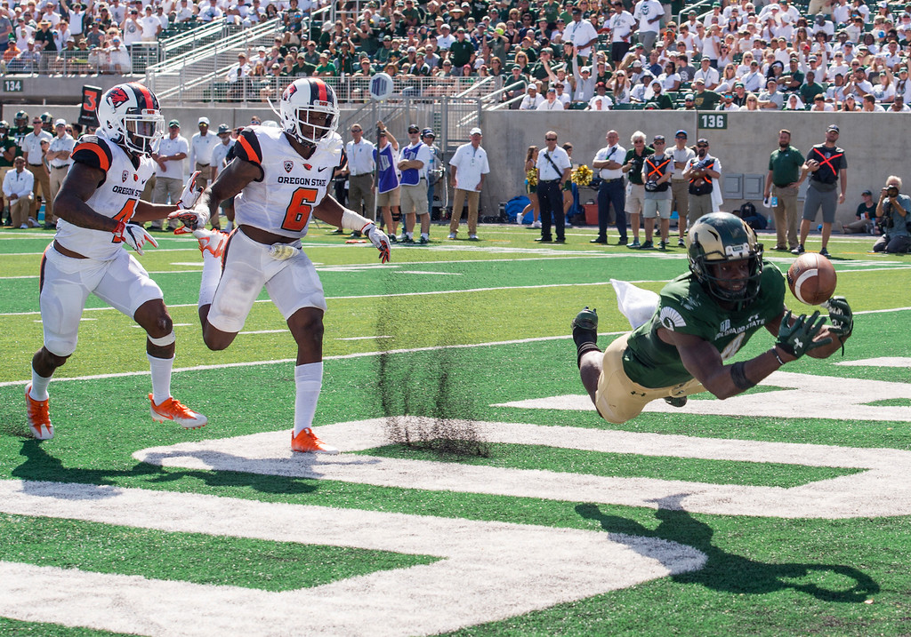 . Colorado State wide receiver Micheal Gallup (4) lays out for a possible touchdown catch against Oregon State Saturday afternoon August 26, 2017 during the Ram\'s inaugural football game at the new on-campus stadium in Fort Collins. The Rams won, 58-27. (Michael Brian/For the Reporter-Herald)