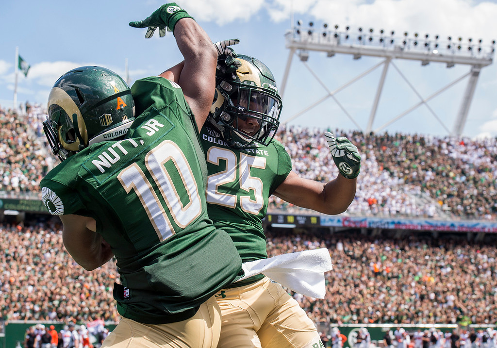 . Colorado State\'s Kevin Nutt Jr. (10) and Darius Campbell (25) celebrate a fumble recovery against Oregon State Saturday afternoon August 26, 2017 at the new on-campus stadium in Fort Collins. The Rams won the game handily, 58-27. (Michael Brian/For the Reporter-Herald)