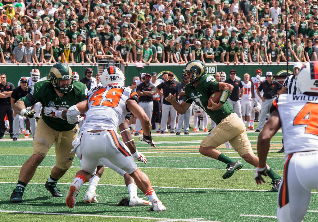 . Colorado State quarterback Nick Stevens (7) takes off from the pocket on a run against Oregon State Saturday afternoon August 26, 2017 in Fort Collins. The Rams won their inaugural new-stadium game, 58-27. (Michael Brian/For the Reporter-Herald)