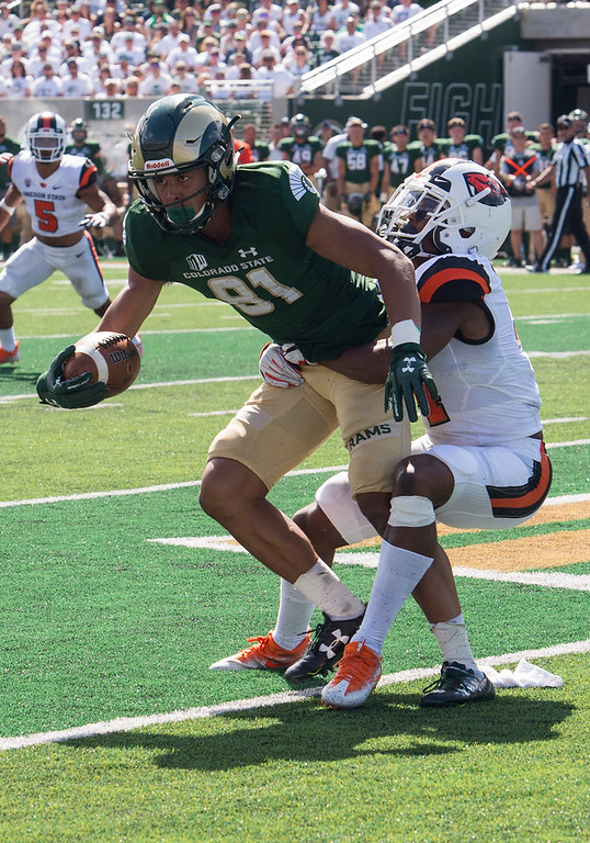. Colorado State wide receiver Olabisi Johnson (81) gets caught from behind by Oregon State cornerback Xavier Crawford (4) Saturday afternoon August 26, 2017 in Fort Collins. The Rams beat the Beavers in their first new-stadium home game, 58-27. (Michael Brian/For the Reporter-Herald)
